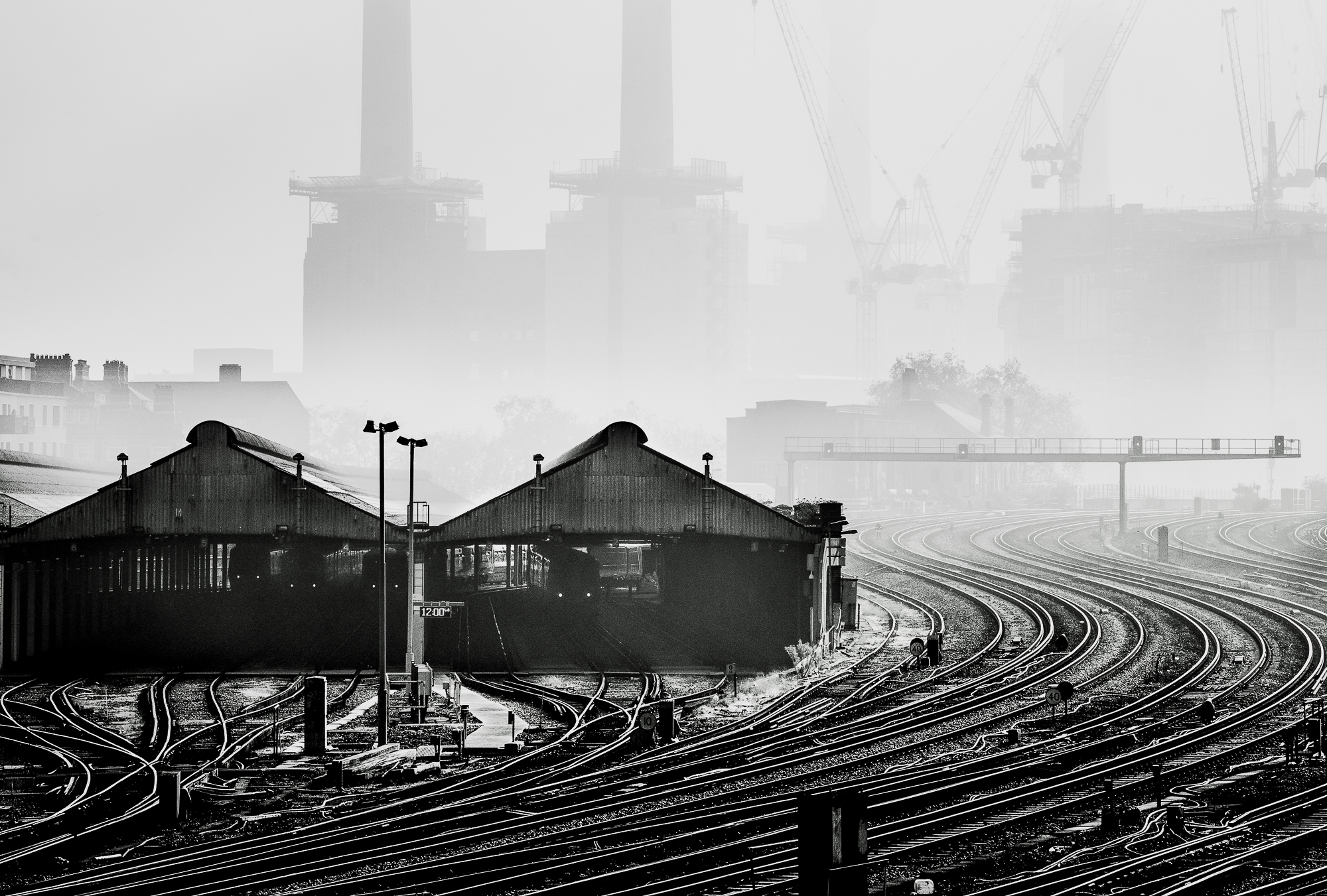 Black and white photograph of the train tracks outside Battersea