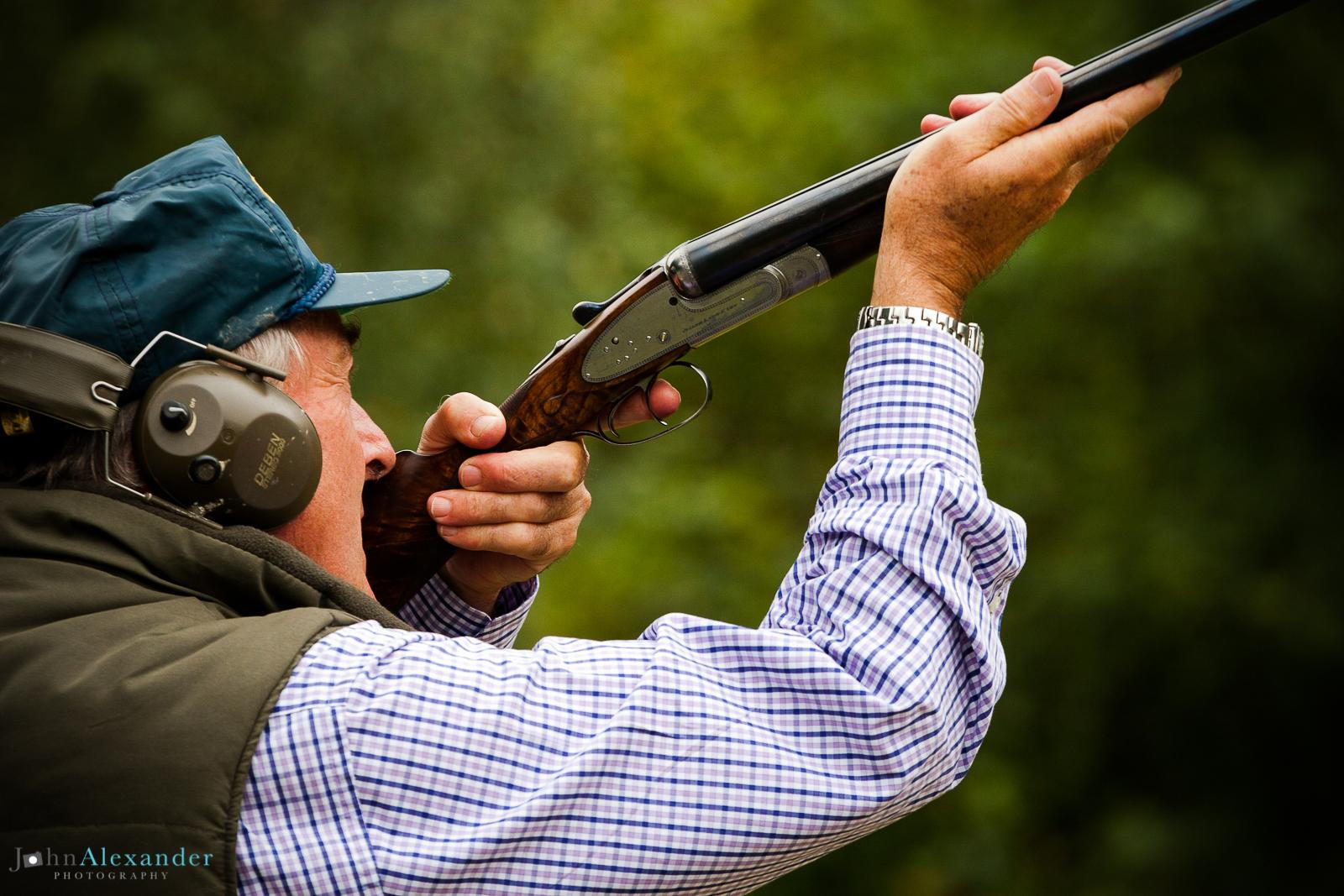 Action shot of gun shooting at pheasant