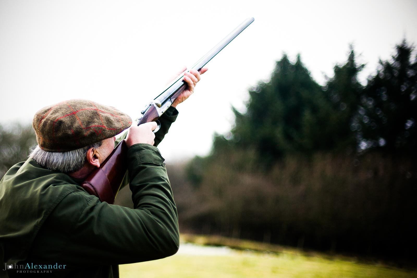 Gun shooting over a spinney