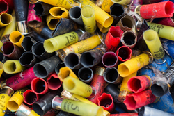 close up of colourful spent shotgun cartridges