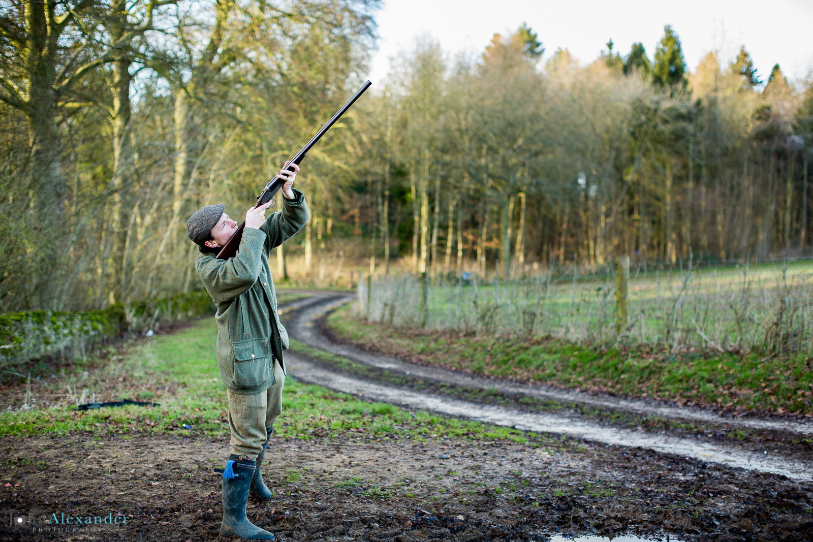 young gun shooting a pheasant from a wood