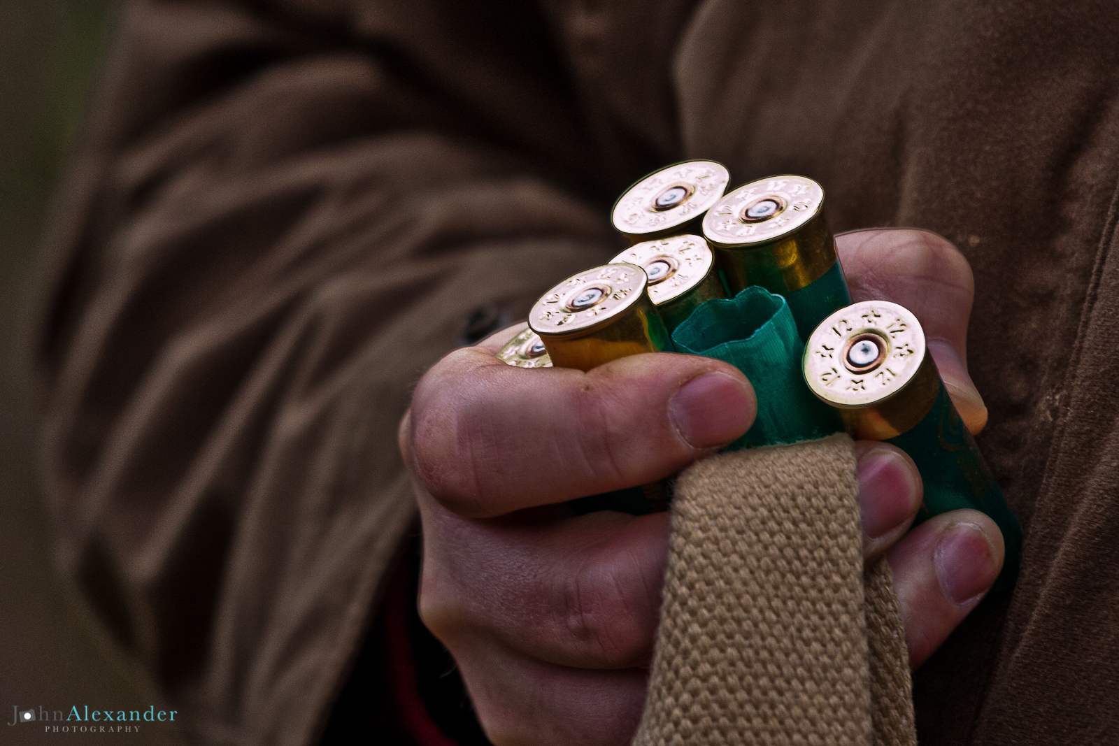 Spent shotgun cartridges in a hand on a pheasant shoot in england. Having been picked up after a drive