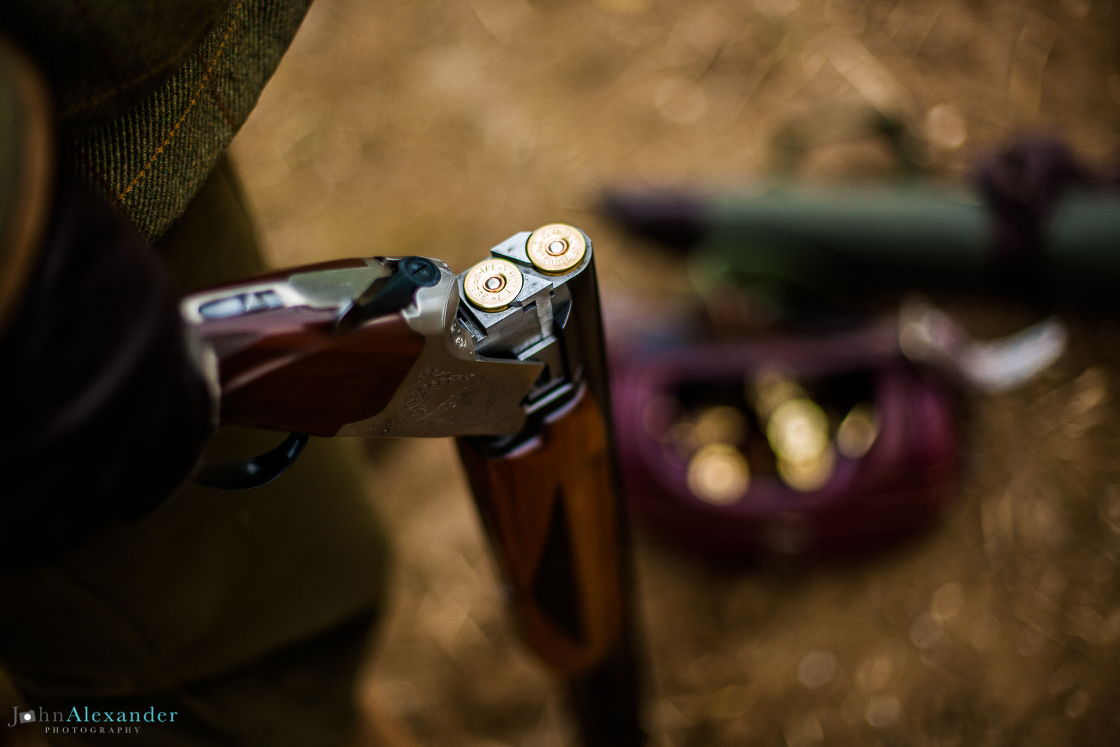 open over and under shotgun with cartridges with loader bag