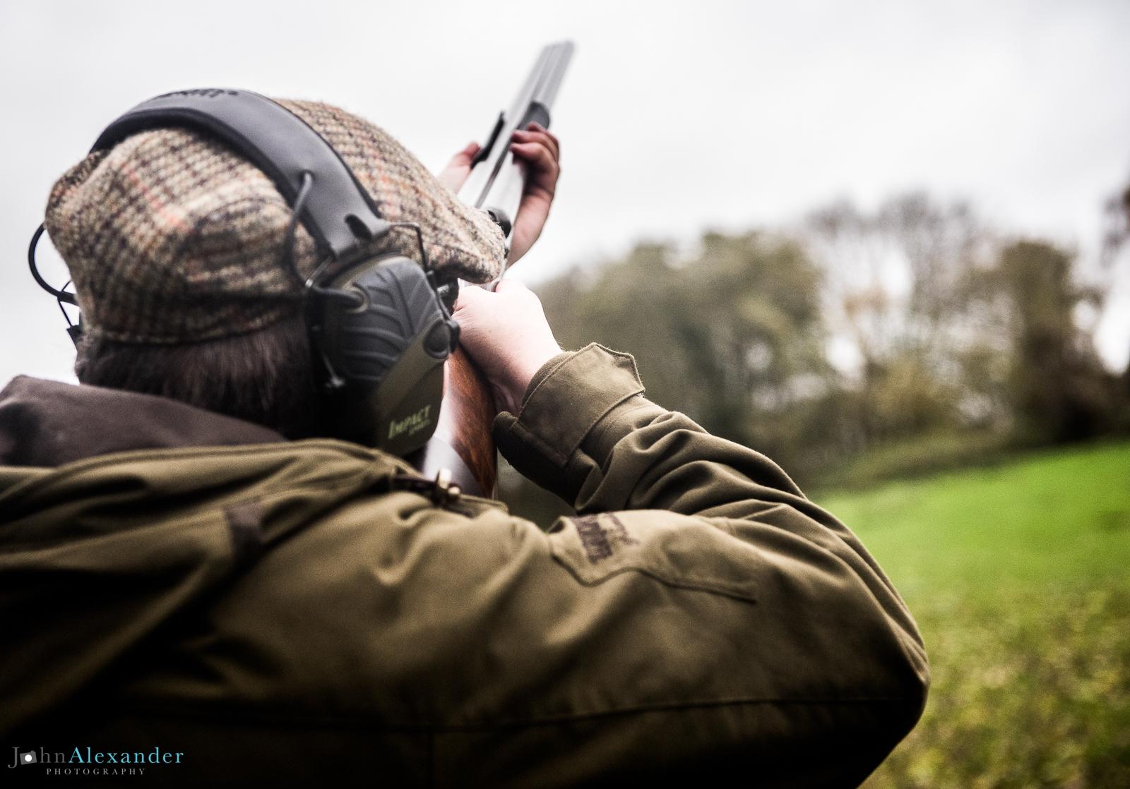 gun shooting pheasants from behind