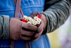 shotgun cartridges in gun's hands