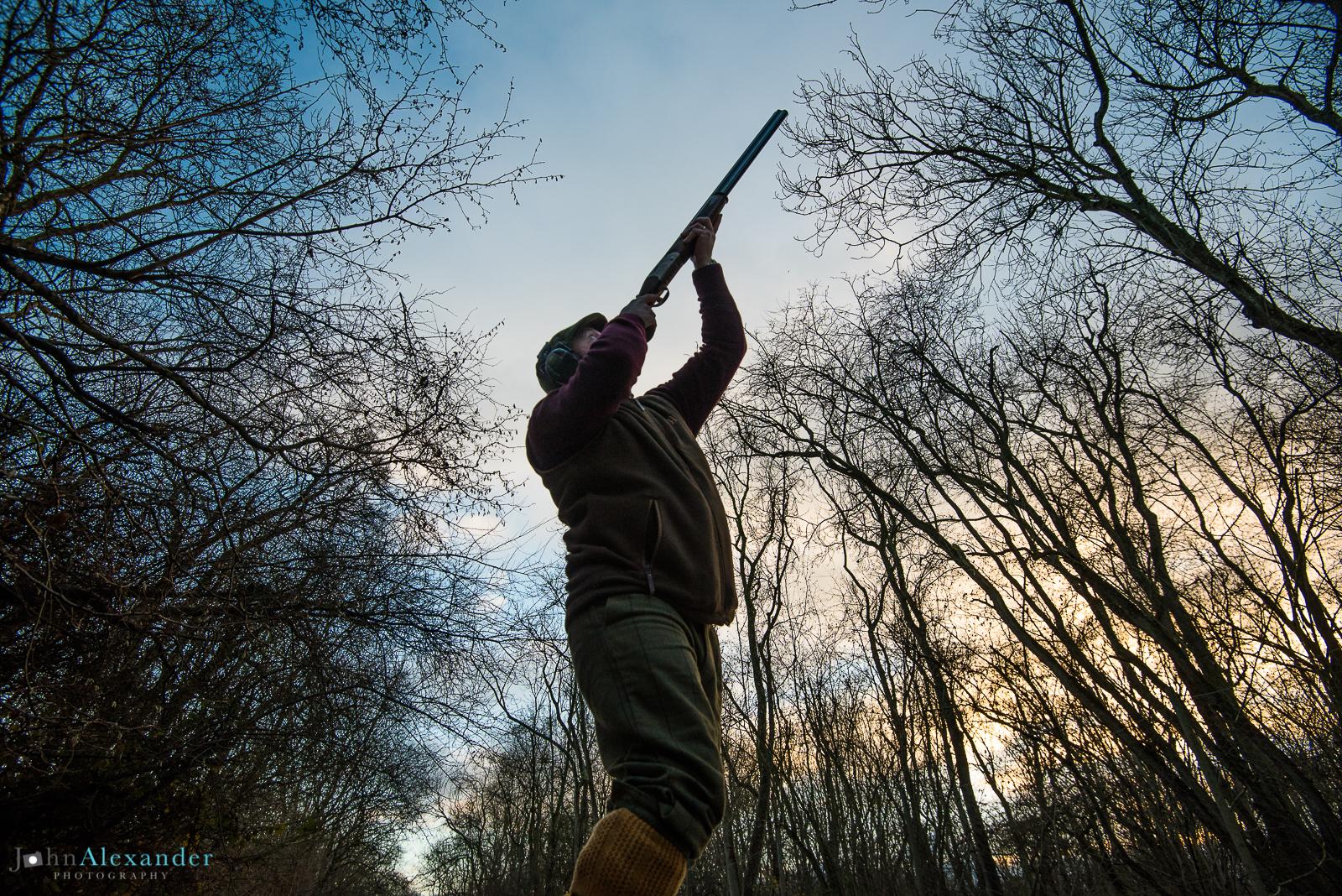 gun shooting in the woods in winter