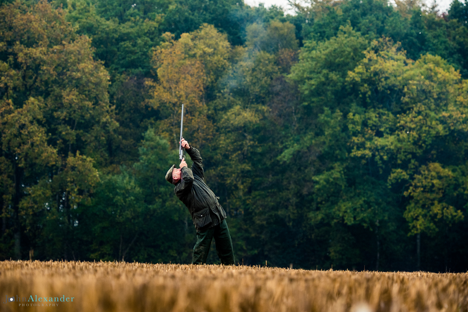 gun shooting a high pheasant in Oxfordshire on driven game shoot