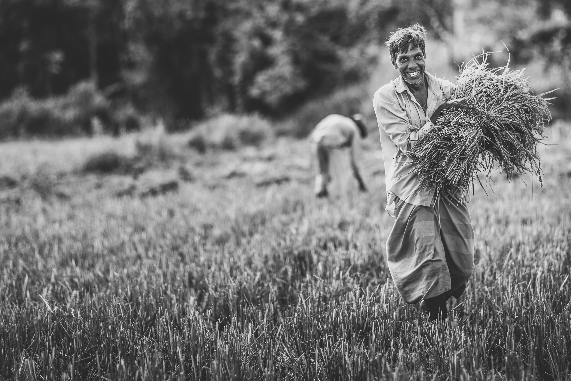 Black and White portrait of farmer bringing in his crop