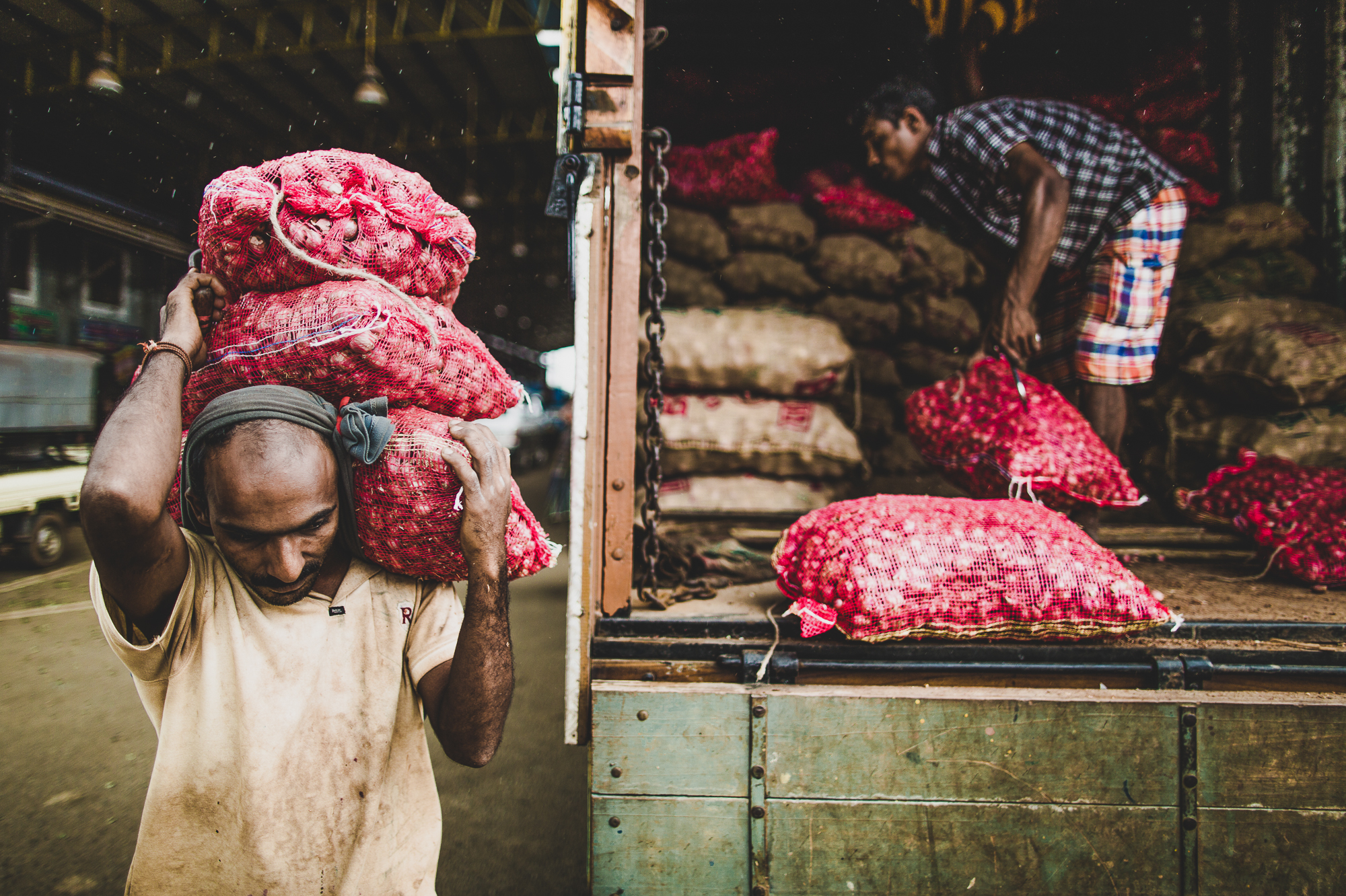Unloading a truck of shallots