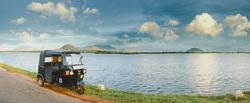 Rickshaw against the lake