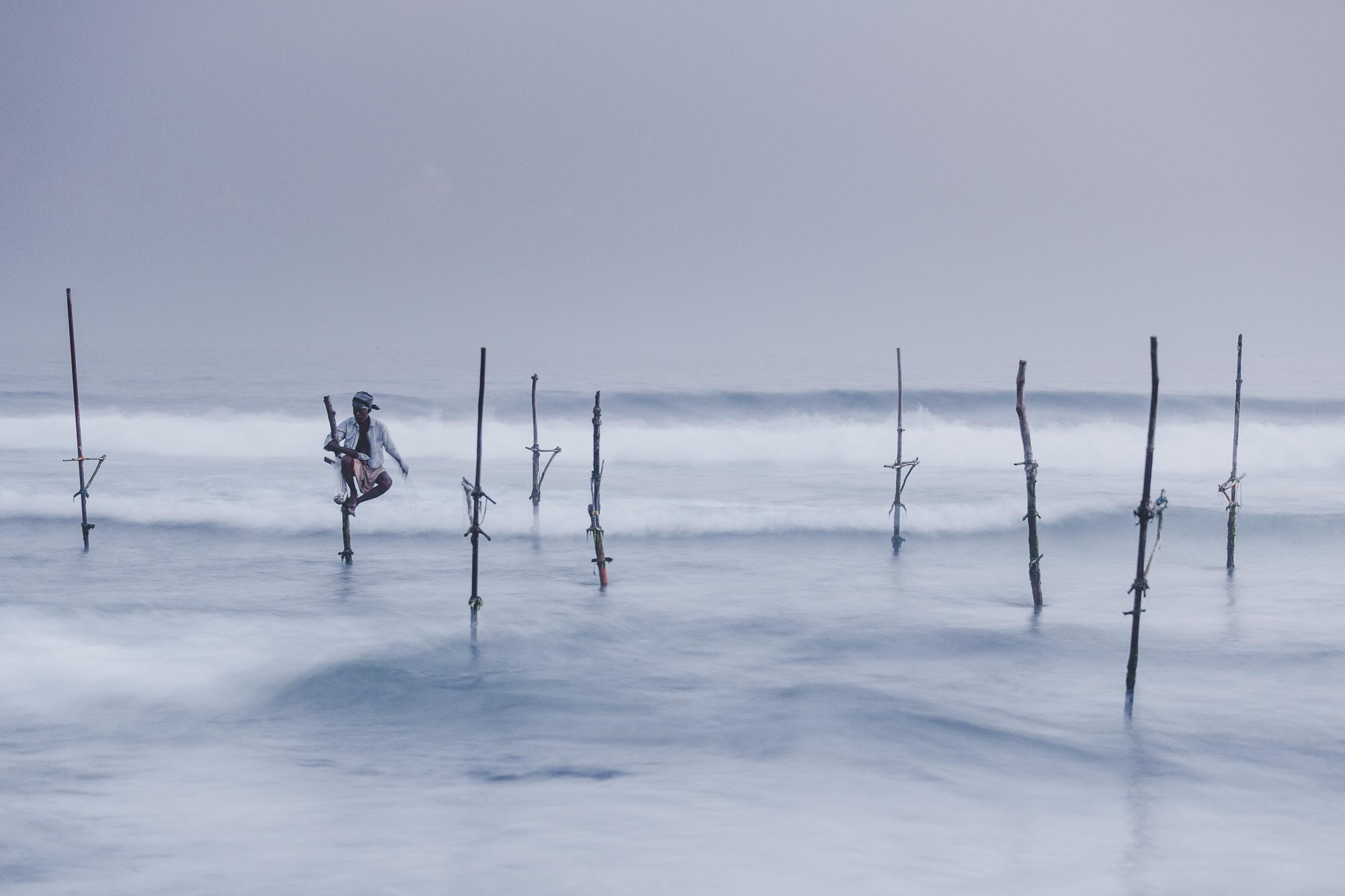 One fishermen on the stilts