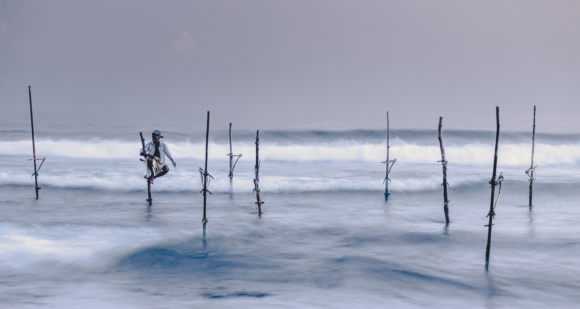Fisherman on his stilt
