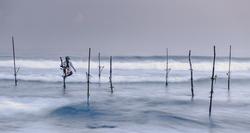 Fisherman on his stilt